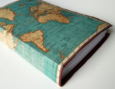 Use maps to cover a trip photo album, books, sketchbook, travel journal. Neat. http://www.jetsetterjess.com/
