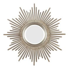 Round wall mirror with a starbust frame and antiqued silver finish.  Product:  Wall mirror  Construction Material: Me...