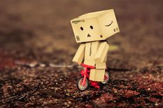 Danbo - Life is like riding a bike. Danbo, Art Quotes, Tattoo Quotes, Cardboard Robot, Box Robot, Amazon Box, Cycling Quotes, Celebrity Travel, Bicycle Design