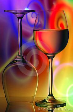 Pair of wine glasses on colorful, vivid abstract background.