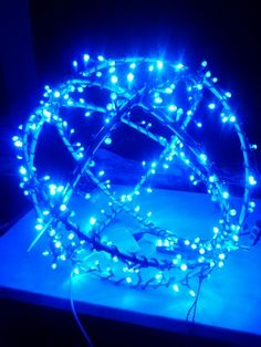 Light ball made with 4 hula hoops from the dollar store. Wrapped each hoop with a set of lights and zip tied them together.  Christmas yard decoration.