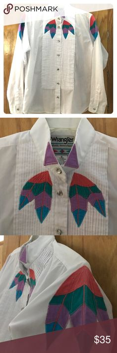 """Vintage Wrangler Tuxedo Shirt Vintage Wrangler Authentic Western Apparel western-style tuxedo shirt. Beautiful buttons and colorful embroidered details on a white cotton-poly blend. GUC with the only issues being a tiny spot shown in last picture that is barely visible and the '80's shoulder pads are gone. It does still have the Velcro strips for the shoulder pads if you want to replace them. 21"""" pit to pit and 24"""" shoulder to hem. Wrangler Tops Button Down Shirts"""