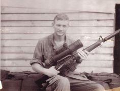11th ACR soldier displays an M16 with starlight scope and silencer attached.