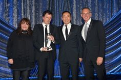 "MAY 14, 2015 (L-R) BMI Vice President of Film and Television Relations Doreen Ringer-Ross, composer Atticus Ross, assistant Vice President, Film/TV Relations at BMI Ray Yee and BMI President and CEO Mike O'Neill pose with the BMI Film Music Award for ""Gone Girl"" onstage during the 2015 BMI Film & Television Awards at the Beverly Wilshire Hotel on May 13, 2015 in Beverly Hills, California. (Photo by Lester Cohen/Getty Images for BMI)"
