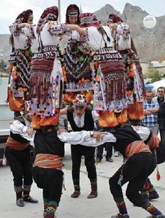 Traditional festive costumes from the Alevi Türkmen villages in the central district of the Tokat province.  Style 1980s, and still in use today.  This dance figure, with the girls standing on the shoulders of the men, is quite unique in Turkish folklore.