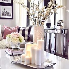 Follow the lead of @homeandfabulous when styling your coffee table and use white pillar candles grouped on a tray.  Vary the candle heights for interest and to create drama.  How simple was that?? #pbstyletip #mypotterybarn
