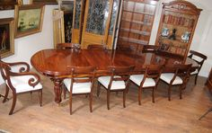 http://canonburyantiques.com/s/dining-tables/victorian-dining-tables/1/  Victorian dining table with set of William IV dining chairs around it. High end dining doesn't get any better than round this Victorian dining table.