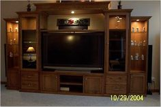 This entertainment center was designed to accomodate a wide range of media, from a large screen TV through a host of other devices. The center section… Tv Unit Furniture Design, Tv Center, Living Room Tv Unit, Living Rooms, Large Screen Tvs, Entertainment Wall Units, Living Room Accents, Bookshelves Built In, Indian Home Decor