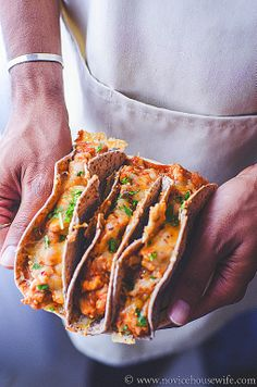 Oven-Baked Chicken Tacos~ Refried beans, ground chicken and tomato sauce go into these cheese topped oven baked chicken tacos. Add a little salsa, lettuce and sour cream on top to add crunch and tang to the dish.