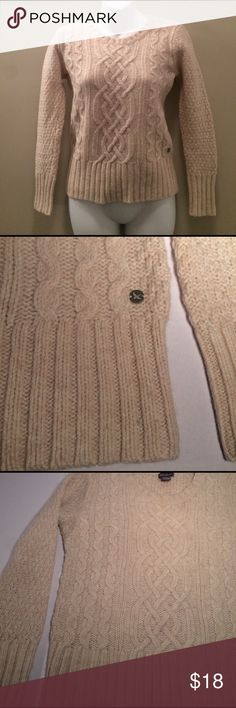 """Eddie Bauer Wool Blend Sweater This Wooo blend Sweater by Eddie Bauer is in good used condition. It has a front design and ribbed cuffs and bottom border. It is a cream color and has a small metal emblem sewn on. This is made of  80% Lambs wool 20% Nylon and is a size Piette Medium and measures approximately 13.5"""" from shoulder to shoulder and 21"""" from shoulder to bottom hem. Eddie Bauer Sweaters Crew & Scoop Necks"""