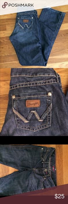 Premium Patch Wrangler jeans Boot cut Premium Patch wrangler jeans, perfect with some cowboy boots this fall. Small amount of fraying at the bottoms. Very little wear anywhere else. Sz 3/4x34 Wrangler Jeans Boot Cut