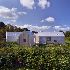 "This Danish summerhouse by Norwegian studio Jarmund/Vigsnæs Architects is split into five buildings ""like a miniature village"""