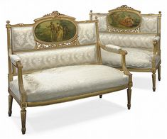 A PAIR OF FRENCH GILTWOOD AND VERNIS MARTIN CANAPES