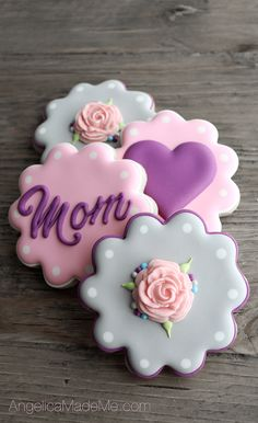 Pink, purple and gray decorated sugar cookies. Fondant flowers, hearts and polka dots make for simple, sweet cookies. Made for mom's birthday, but great for Mother's Day.