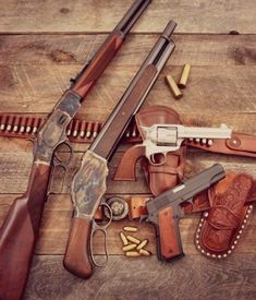 Is there a better combo of classic firearms? Winchester, Mare's leg, Colt SAA, and a 1911 with the leather to match. This makes me happy.