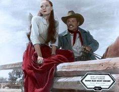 THE UNFORGIVEN (1960) - Audrey Hepburn & Audie Murphy watch a horse being broken - Based on novel by Alan LeMay - Directed by John Huston - United Artists - German Lobby Card.