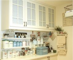 .little shelves under cabinets- pretty and useful