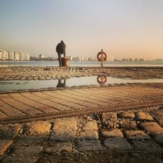 Reflecting by the sea. Walking Thessaloniki app, Route 01 - Port (Download for FREE) #lifesaver #travel #guide #Greece Commercial Street, Thessaloniki, Life Savers, Uber, Monument Valley, Travel Guide, Greece, Louvre, Walking