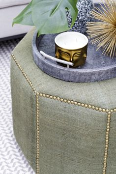 Stud detail on Octagonal Pouffe combined with shagreen tray creating a coffee table for the sitting area