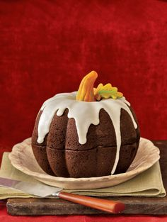Pumpkin Bundt Cake. (2 bundt cakes put together to form punpkin). NO recipe but you can learn to make one here >  http://amerrierworld.com/2009/11/02/the-great-pumpkin-cake/ Love this!