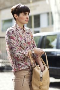Shop this look - floral top, beige trousers & tan bag