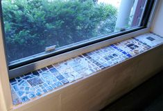 My finished windowsill mosaic - OMG!! a perfect solution to my window sill problem, I love this!