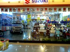 A closeup of the Suzuki Car and Motorcycle dealership in the basement of Future Park Mall in Rangsit (Bangkok) Thailand