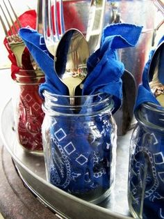 4th of July Cookout Idea: Everyone will have their own jar w/ a bandana napkin their silverware. Then they can fill up their jar w/ ice enjoy iced tea or lemonade right from the mason jar. I would add a straw.
