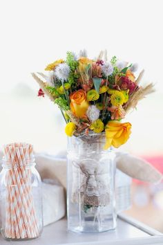Used vases for bridal flowers & paper straws for drinking :)