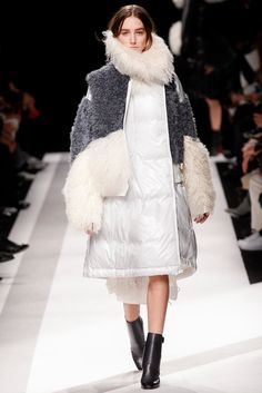 Sacai Fall 2014 - Among the parade of extravagant coats in Chitose Abe's Fall 2014 Sacai collection was this gorgeous white puffer with shearling trim. Chances are, in this coat, you'd never be cold again.