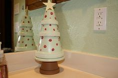 Terra cotta tree--painted garden pots...could embellish with gorgeous costume jewelry, too!