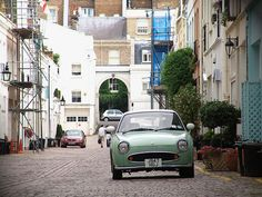 I just love this little car. parked in the perfect environment: to match with it: a mews. Figaro Car, Nissan Figaro, Retro Cars, Vintage Cars, My Dream Car, Dream Cars, Japanese Market, Photographs Of People, Dream Garage