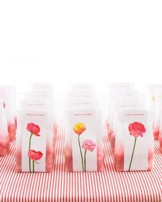 glassine bag with floral printed paper.  Floral sticker clip art included from Martha Stewart Wedding