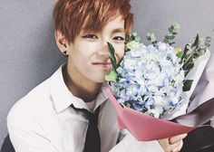 He is prettier than the flowers #v #kimtaehyung #bts
