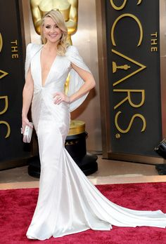 Brides.com: The Best Dresses at the 2014 Oscars. Kate Hudson in Versace. Capes are becoming a major red carpet look, and we love it! The beaded cape she wore with her plunging V-neck dress is so dramatic, and just the kind of detail that a princess-like bride should include!  See more V-neck dresses.