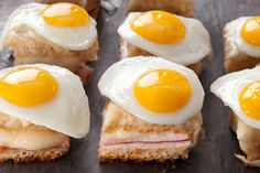 Mini Croque Madames with QUAIL EGGS! (1 2/3 cups shredded Gruyère cheese (about 5 ounces), 8 slices white sandwich bread, 6 tbsp unsalted butter (3/4 stick), 1 tbsp all-purpose flour, 1/2 cup whole milk, 1/4 tsp kosher salt, plus more as needed, pinch ground nutmeg, 4 ounces thinly sliced cooked ham, Dijon mustard, 16 quail eggs, and 2 tbsp vegetable oil)