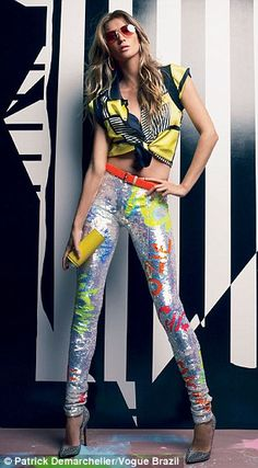 Gisele in yellow and black print top and graffiti inspired skinny pants and red belt