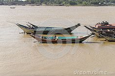 Port in Yangun, Myanmar (Burma) . Boats on the river.  http://en.wikipedia.org/wiki/Yangon http://www.mot.gov.mm/mpa/ygn_ports.html