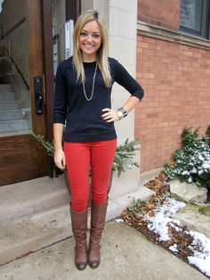 Business casual work outfit: navy sweater, red skinnies, brown boots.