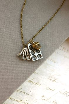 A Bakers Necklace. A Measuring Spoon Silver Miniature