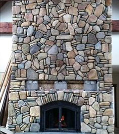 I love this fireplace. Can you imagine coming home to a roaring fire.
