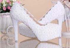 Walk or dance in the night with comfort with this gorgeous pair. This pair features floral lace with pearl details, round toe, slip on design and heels covered with shinny pearls. Crafted from PU, rub