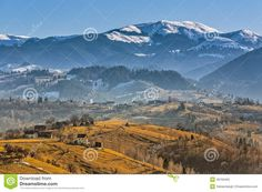 Rural mountain landscape with remote Romanian village uphill in the valleys of Bucegi mountains, Brasov county, Romania.