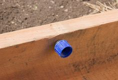 SwingNCocoa: DIY Raised Garden Bed Built In Soaker Hose {Next Year Idea}