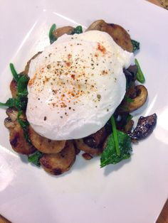 Poached Eggs over spinach and mushroom and sausage