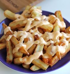 Garlic Cheese Fries - Perfectly double-fried french fries smothered in a garlic cheese sauce that can be made in 5 minutes! Pinning for the Garlic Cheese Sauce. I Love Food, Good Food, Yummy Food, Tasty, Food Porn, Garlic Cheese, Garlic Sauce, Cheese Fries, Nacho Cheese