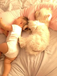 So sweet.  Westie and baby love