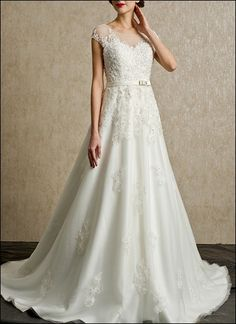 Sleek, belted lace gown with transparent sleeves