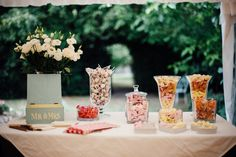 Sweet table in the marquee with a guest book! © Susie Lawrence Photography #luxuryweddingsfrance #frenchweddings #rusticweddings #rustic #weddingideas #weddingsabroad #bellevue #southwestfranceweddings #love #marriage #weddings #countrysidewedding #summerwedding #susielawrence #guestbook #sweets #weddingsweets #weddingfavours