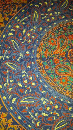 A mandala throw in blue & orange. Flowers, camels, birds & other abstract patterns block printed in shades of blue, white & orange.